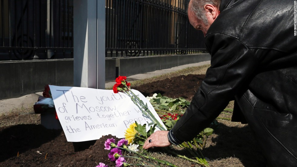 A man puts flowers near the U.S. Embassy in Moscow on Tuesday.