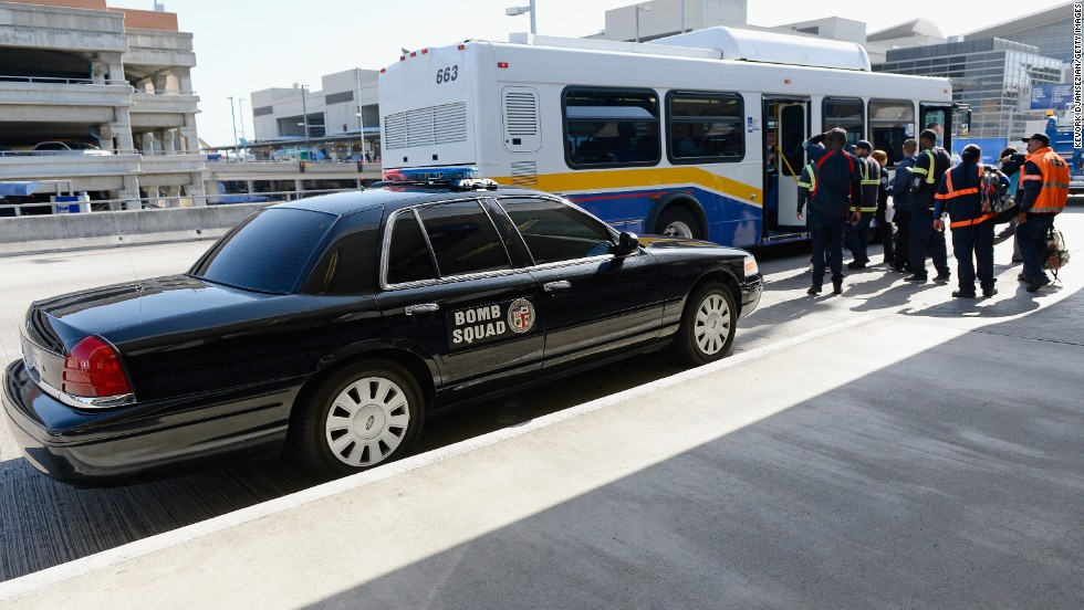 A bomb squad vehicle is parked at the Los Angeles International Airport departures terminal on Monday.