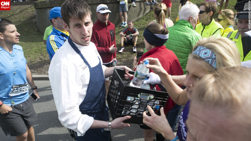 "<a href=""http://ireport.cnn.com/docs/DOC-957434"">Catalano</a> says he saw spectators run into their houses and dorm rooms to grab blankets, jackets and water to give to runners."