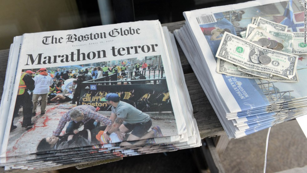 The bombings dominate the front pages of newspapers at a newsstand on Newbury Street in Boston.