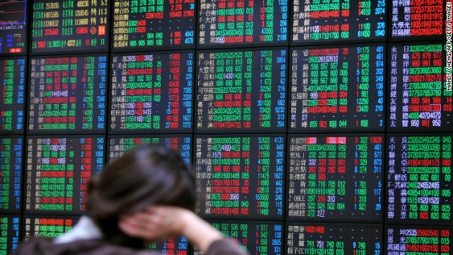 An investor monitors the stock market at a securities brokerage in Taipei on April 16, 2013. Asian shares were mixed on April 16, with earlier losses pared after a huge sell-off on Wall Street, while traders were spooked by a double bombing that hit the Boston Marathon.