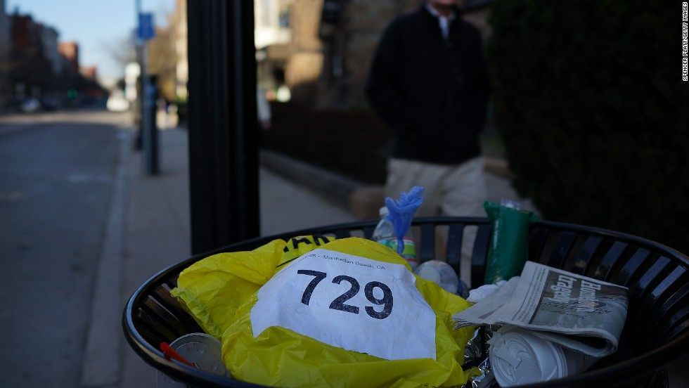 "A runners bib lies discarded April 16. <a href=""http://www.cnn.com/SPECIALS/us/boston-bombings-galleries/index.html"">See all photography related to the Boston bombings.</a>v"