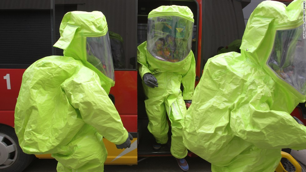 "Emergency service personnel wearing chemical protective clothing participate in an anti-chemical warfare exercise on Tuesday, April 16 in Seoul. Tensions remain high in the Korean Peninsula in the wake of North Korea's recent nuclear threats and provocations. A Pentagon intelligence assessment suggests the North may have the ability to deliver a nuclear weapon with a ballistic missile, though the reliability is believed to be ""low."""