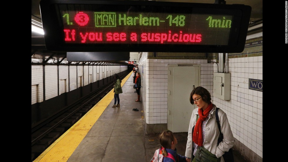 A message asking passengers to report suspicious activity flashes on an electronic sign inside a New York City subway station on Tuesday.
