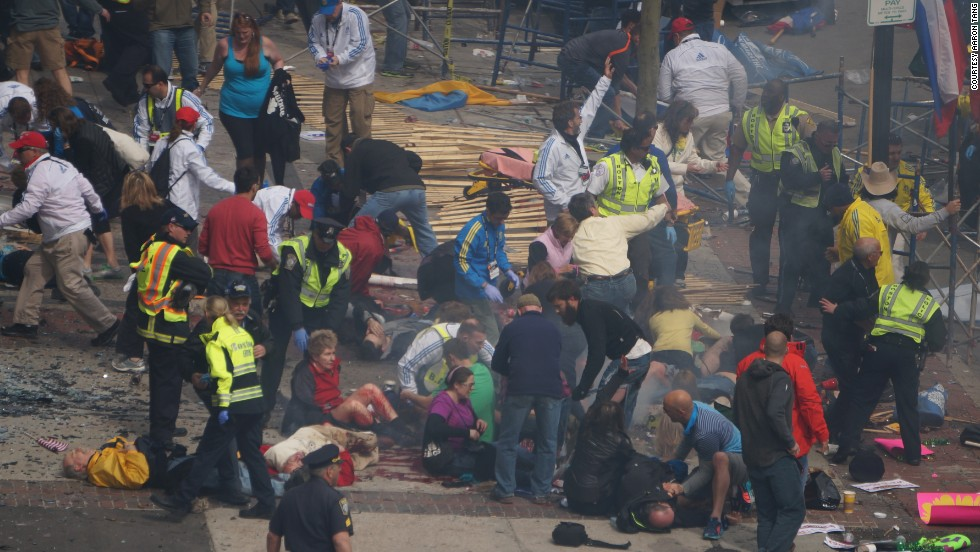 Injured people lie on the ground.