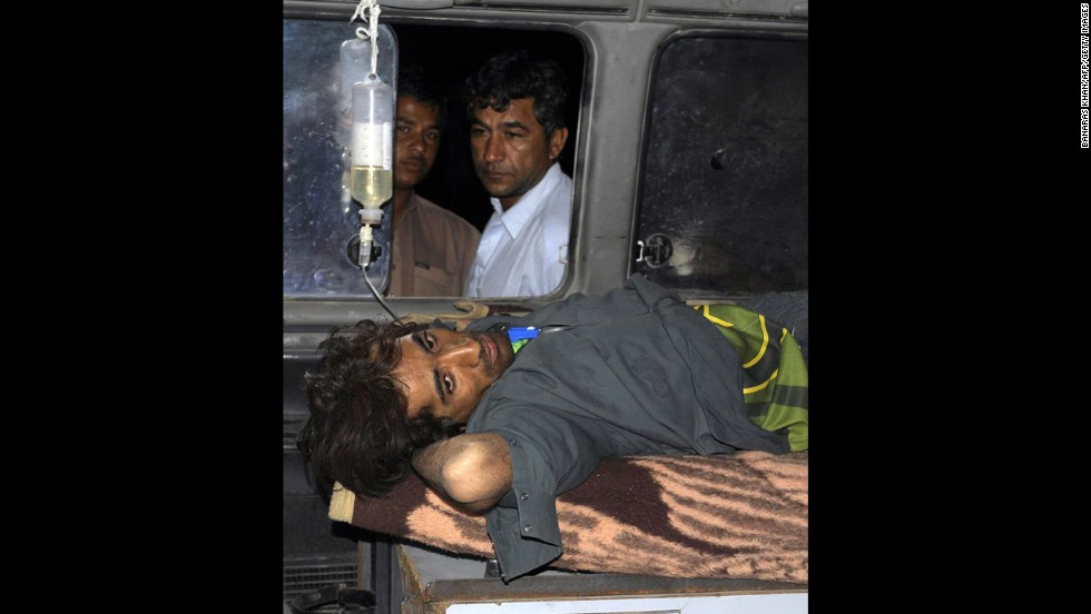 An injured Pakistani man lies in an ambulance outside a hospital in the town of Dalbandin in southwestern Baluchistan province on Wednesday.