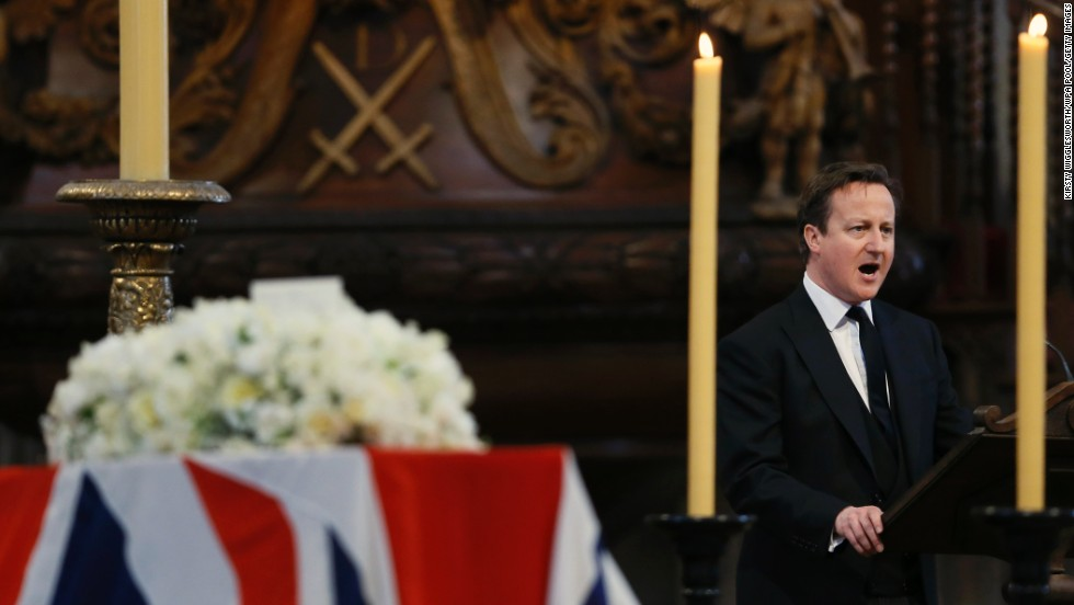British Prime Minister David Cameron delivers a reading during the service.