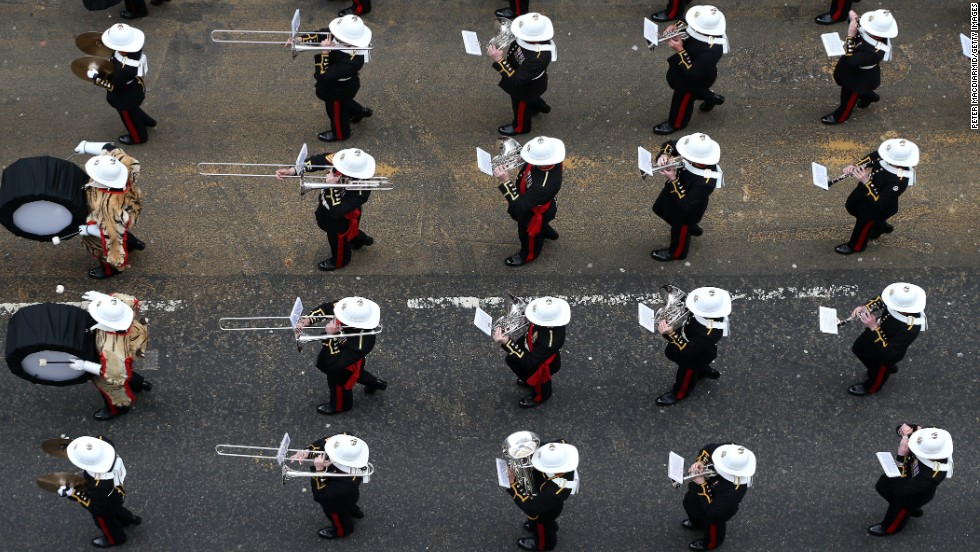 A military band marches past on Fleet Street.