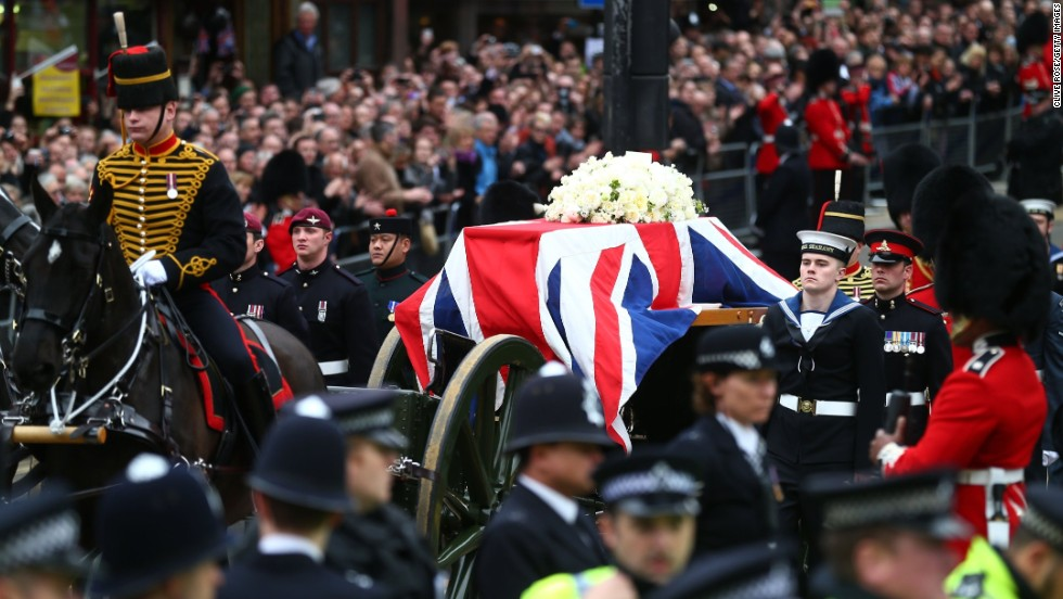 The gun carriage carrying the coffin is drawn by the King's Troop, Royal Horse Artillery.