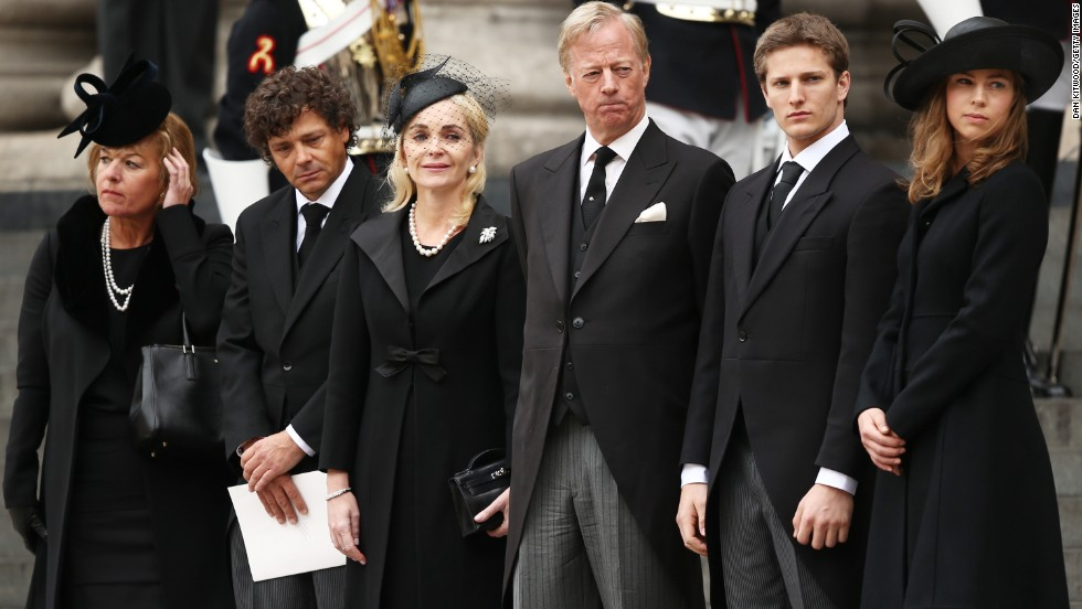 Carol Thatcher, Marco Grass, Sarah Thatcher, Mark Thatcher, Michael Thatcher and Amanda Thatcher watch from the steps of St. Paul's Cathedral as the coffin is placed in the hearse after the funeral.