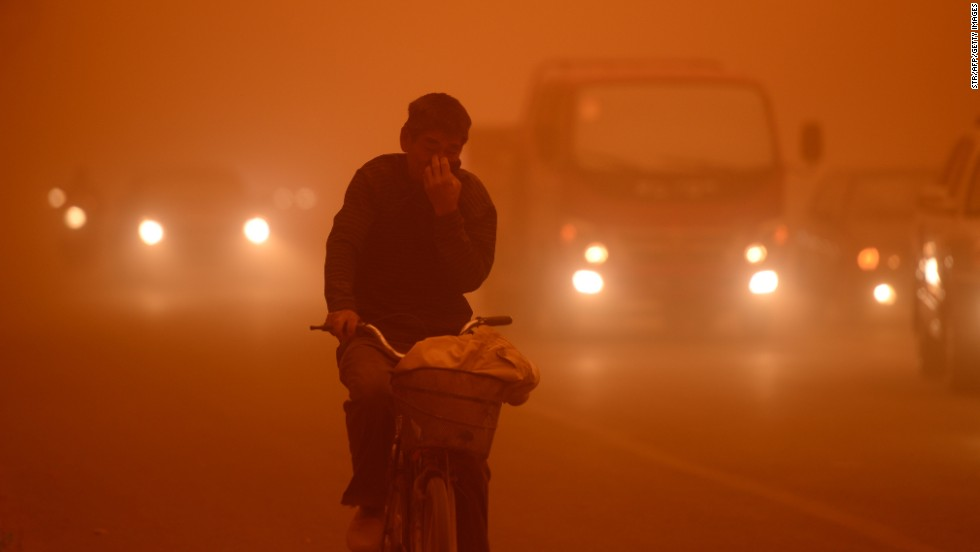 A man rides a bike during a heavy sandstorm in Yecheng county, northwest China's Xinjiang Uygur Autonomous Region, on Tuesday, April 16.