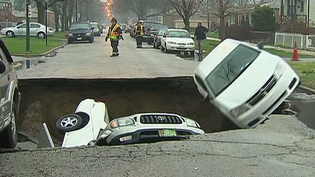 See sinkhole swallow car