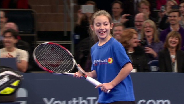 Little girl takes on tennis giants