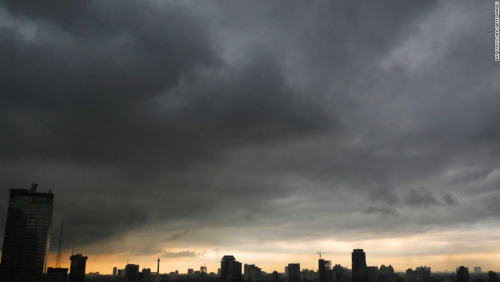Dark clouds hang over the Indonesian capital of Jakarta on April 18.