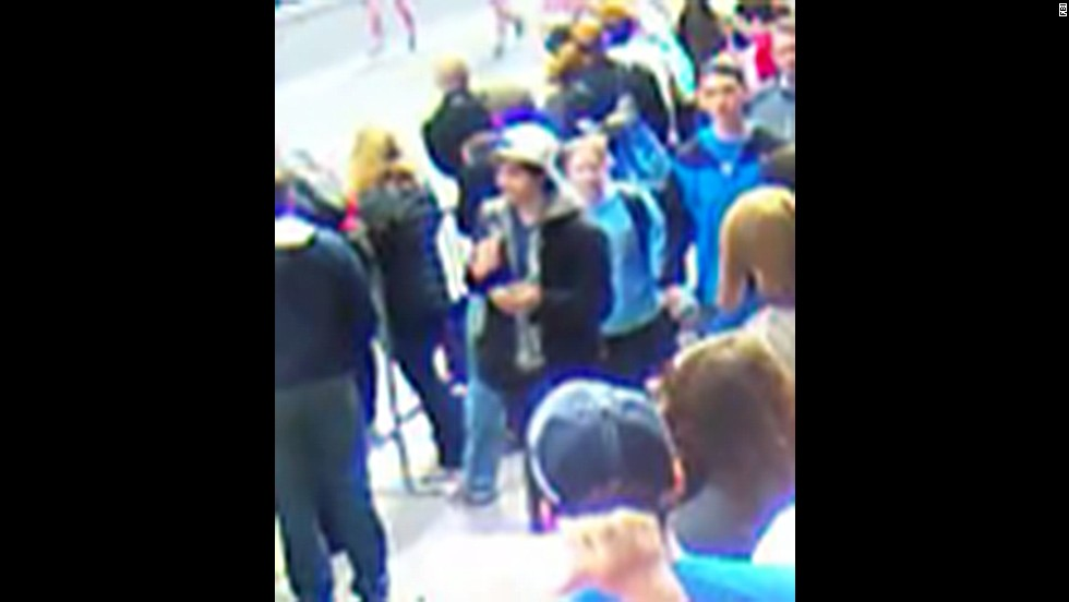 "Suspect 2 walks through the crowd. <a href=""http://www.cnn.com/SPECIALS/us/boston-bombings-galleries/index.html"">See all photography related to the Boston bombings.</a>"