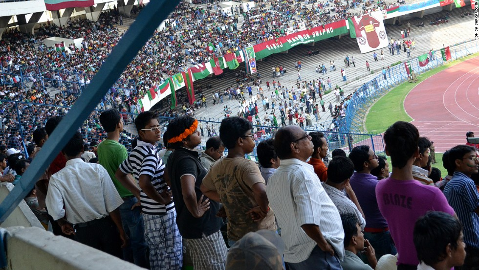 Kolkata's Saltlake football stadium is one of the largest in Asia, with a capacity of 120,000. Pictured here, supporters of the oldest team in the country -- Mohun Bagan A.C. -- watch their team play an I-League match against Pune F.C in May 2012. Kolkata is the birthplace of Indian football, with British soldiers introducing the sport in the 19th century.