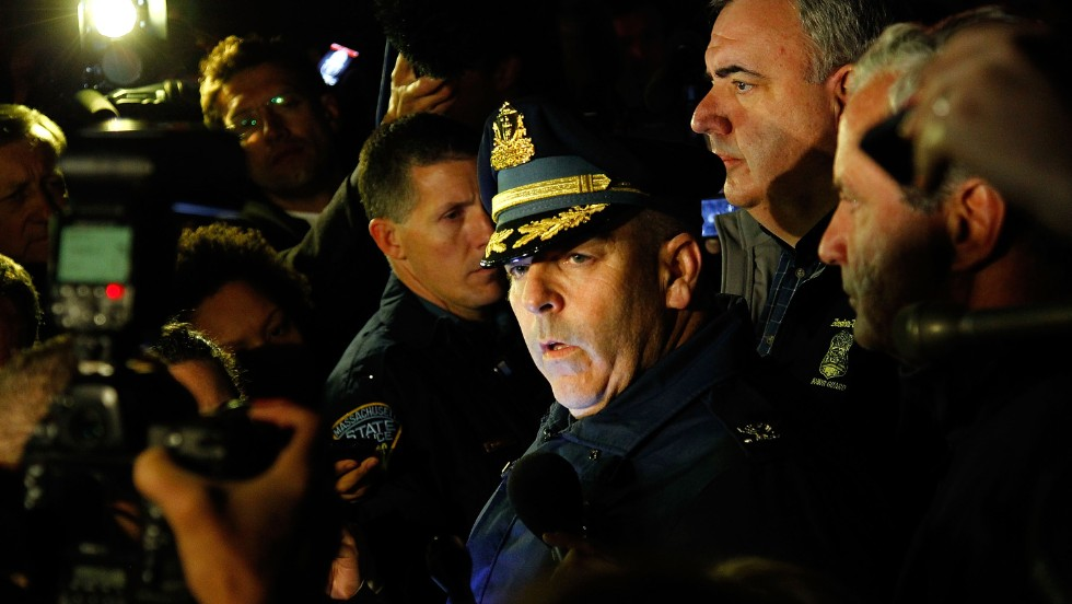 Boston Police Commissioner Edward Davis speaks to the media on April 19, 2013, and explains that the city is on lockdown until the surviving suspect is found.