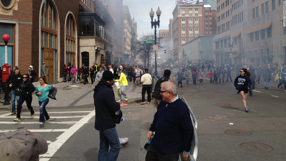 FBI Suspect No. 2, later said to be Dzhokhar Tsarnaev, is apparently seen in this picture, far left in white cap. The photo was taken by Boston Marathon runner David Green at the scene of the bombings.