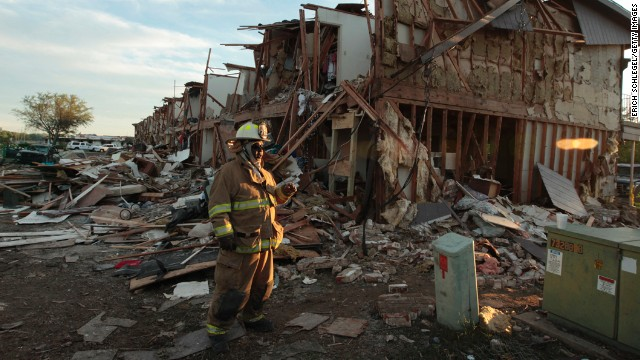 WEST, TX - APRIL 18: A Valley Mills Fire Department personnel walks among the remains of an apartment complex next to the fertilizer plant that exploded yesterday afternoon on April 18, 2013 in West, Texas. According to West Mayor Tommy Muska, around 14 people, including 10 first responders, were killed and more than 150 people were injured when the fertilizer company caught fire and exploded, leaving damaged buildings for blocks in every direction. (Photo by Erich Schlegel/Getty Images)