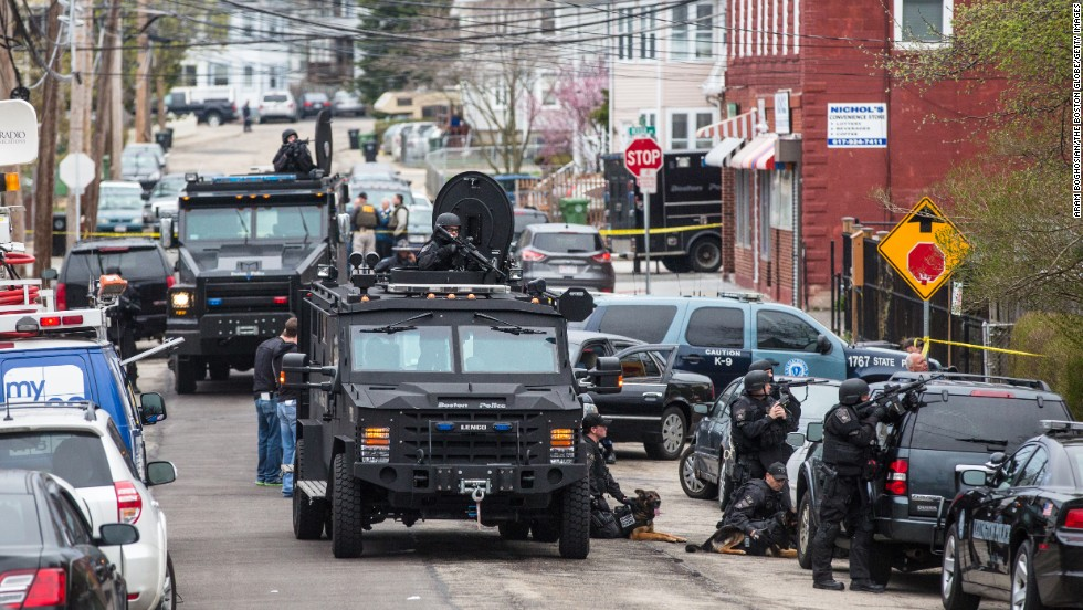 SWAT teams move into position at the intersection of Nichols and Melendy avenues in Watertown, Massachusetts, on Friday.