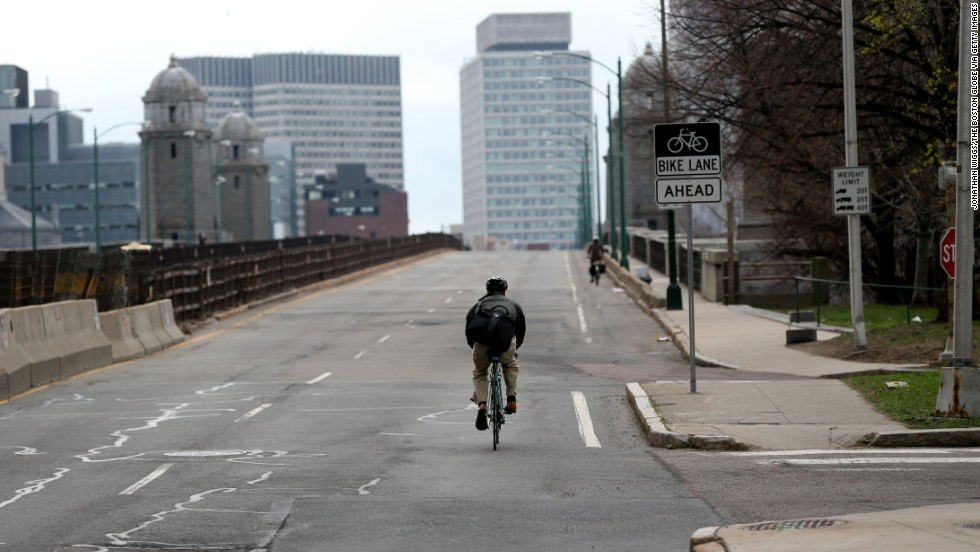 A lone bicyclist makes his way across the Longfellow Bridge.