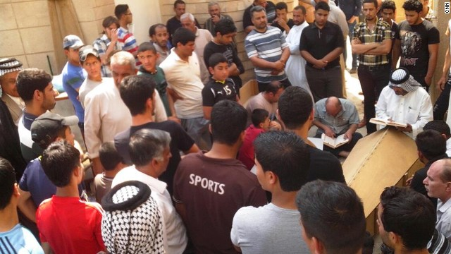 Mourners give their condolences to family members of the victims who were killed in the explosion in Al- Amirya.