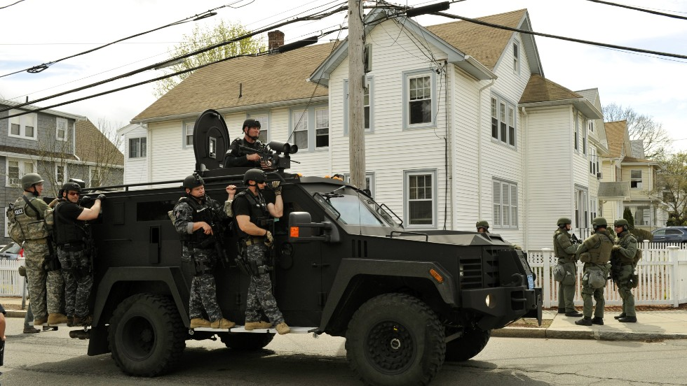 SWAT teams continue to search in Watertown on April 19, 2013.