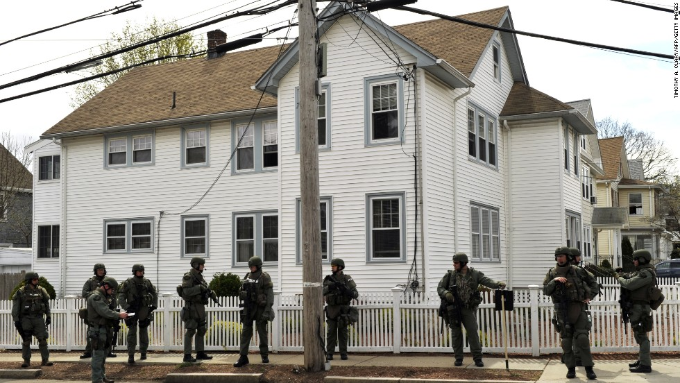 SWAT team members line a residential street in Watertown, Massachusetts, as the manhunt continues on Friday.