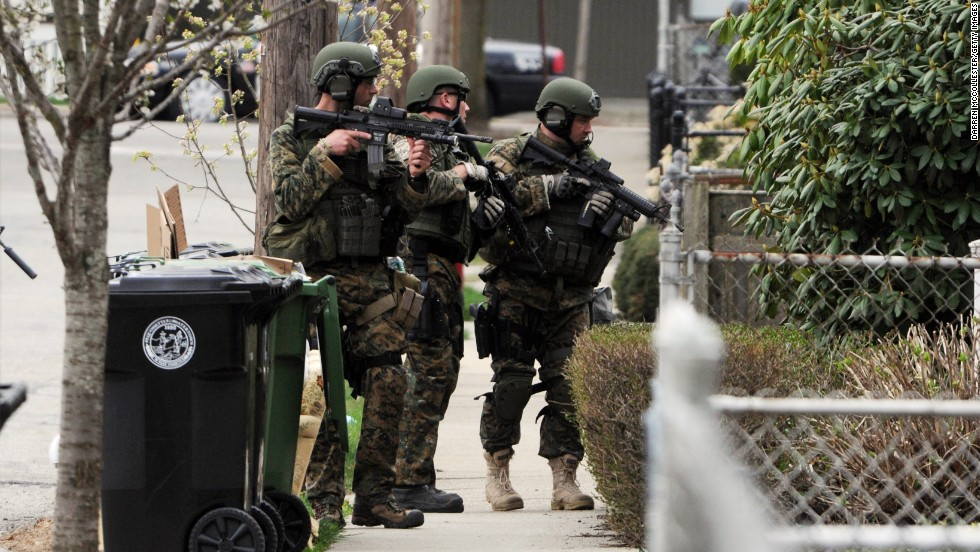 Police to continue to the door-to-door search on Francis Street in Watertown, Massachusetts, on Friday.