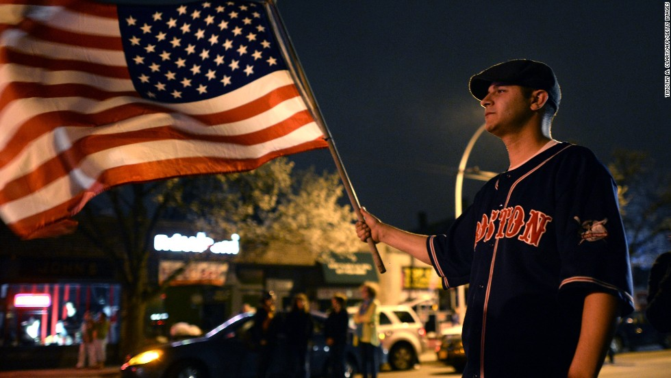 A man waves a U.S. flag in Watertown on April 19.