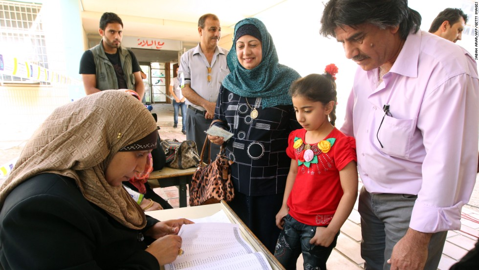 Iraqis cast their ballots at a polling station on Saturday in Baghdad.