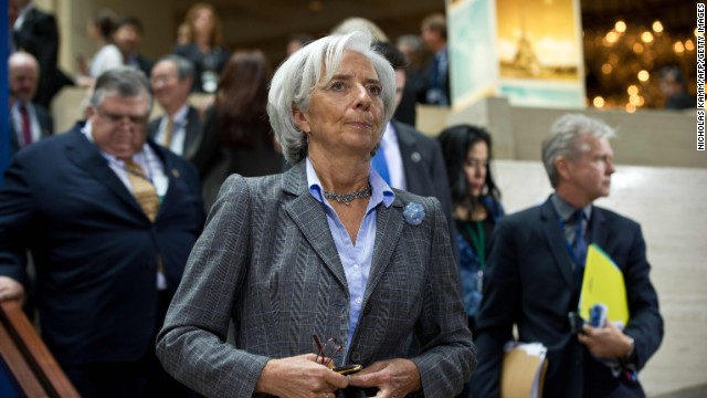 International Monetary Fund (IMF) Managing Director Christine Lagarde arrives for a family photo of finance ministers and central bank governors following the G20 meeting at the 2013 World Bank/IMF Spring meetings in Washington on April 19, 2013.