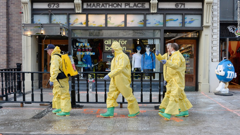 The Boston Fire Department Hazardous Materials team cleans the first blast site near the finish line of the Boston Marathon on April 22.
