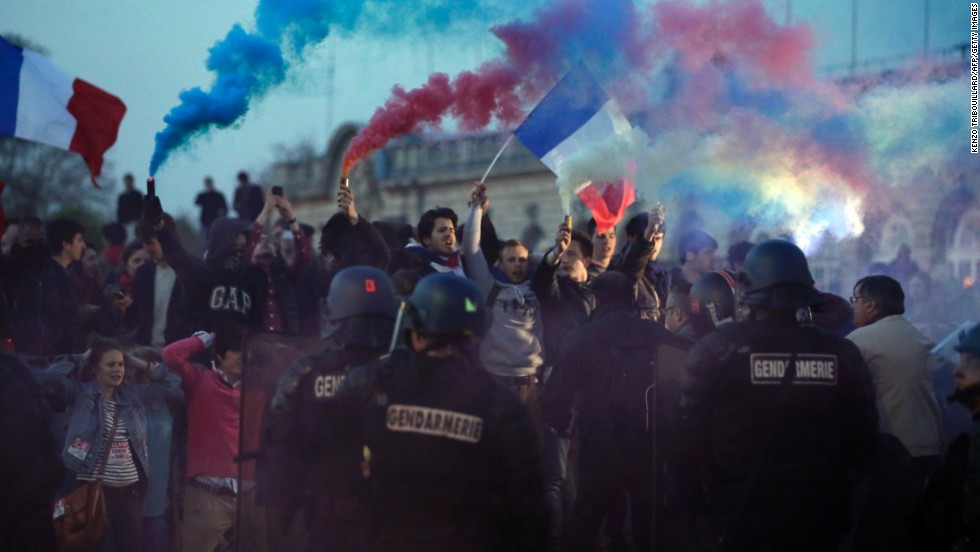 "Opponents of a gay marriage bill face riot officers at ""La Manif Pour Tous,"" or demonstration for all, on Sunday, April 21."