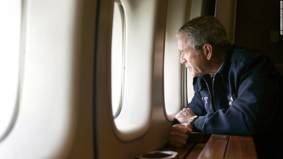 George W. Bush surveys Hurricane Katrina damage through the window of Air Force One as it flies over New Orleans, Louisiana, on August 31, 2005.