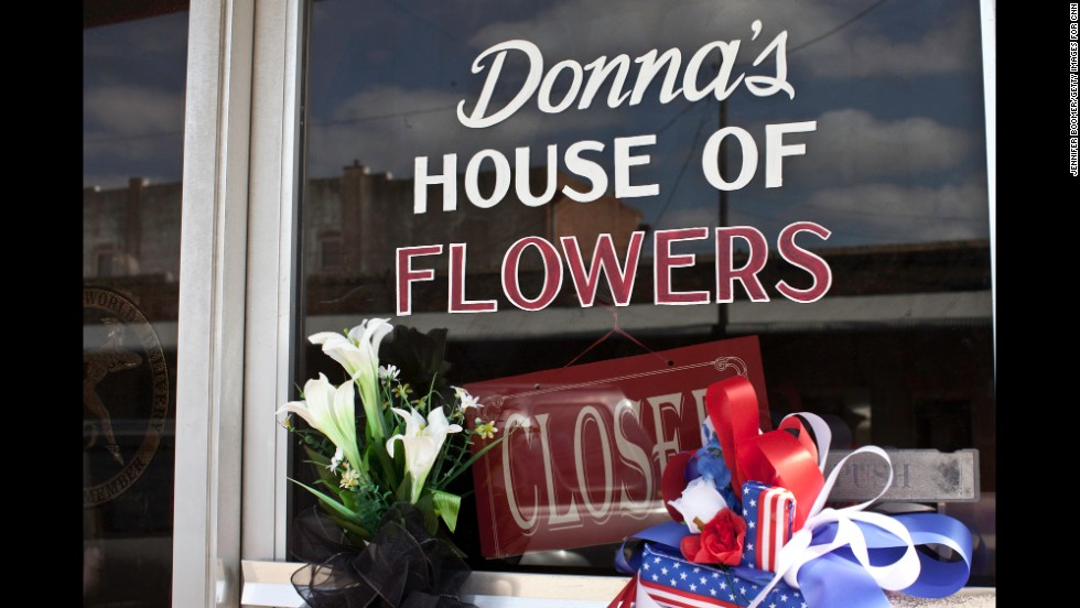 Donna's House of Flowers is closed, and a note on the door explains the tragic reason: Her husband and brother-in-law, both volunteer firefighters, died in the explosion.