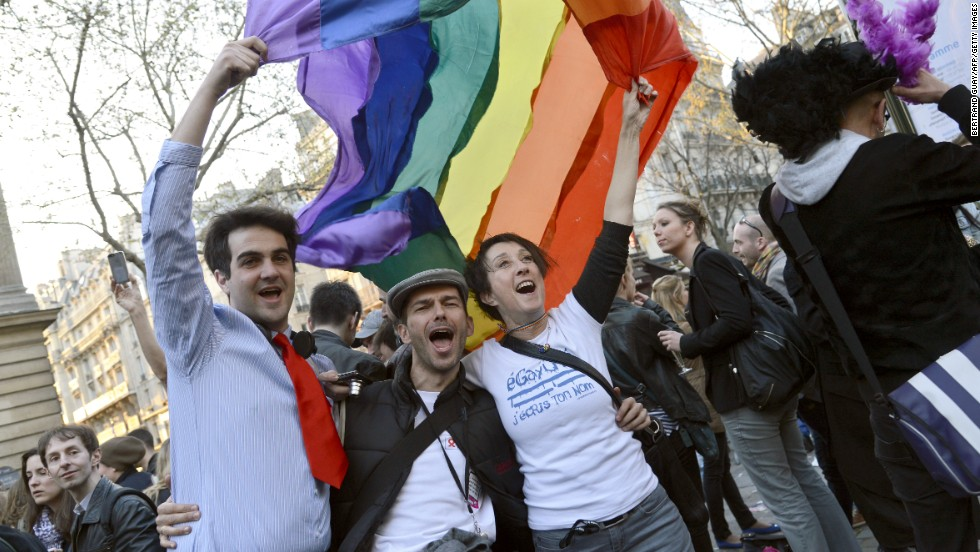 "People celebrate at Paris City Hall on Tuesday, April 23, after the <a href=""http://www.cnn.com/2013/04/23/world/europe/france-same-sex-vote/index.html"">French National Assembly adopted a bill legalizing same-sex marriage</a> and adoptions for gay couples."