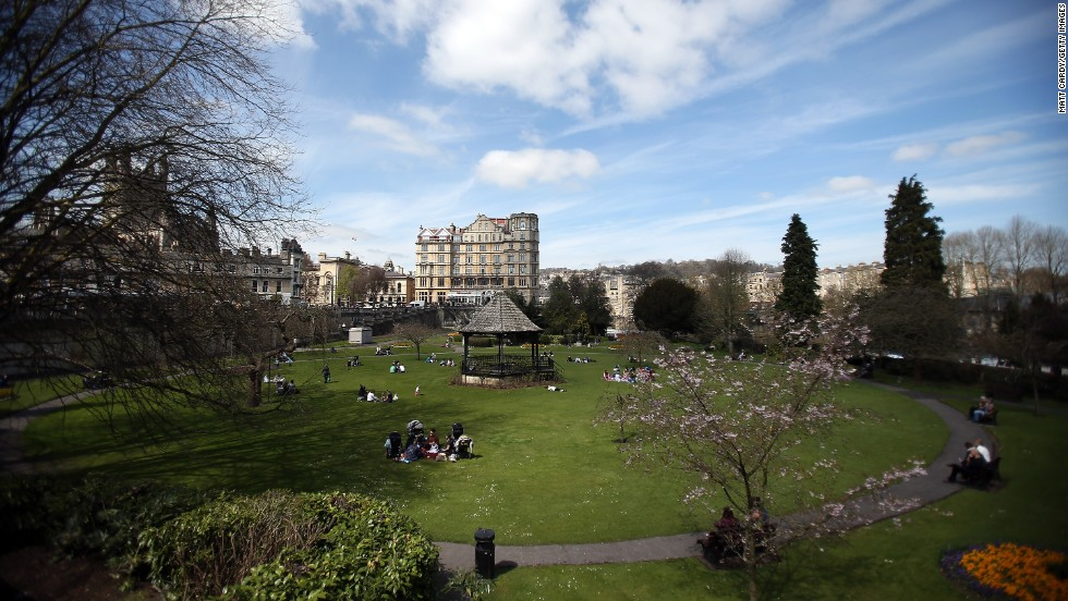 People take in the spring sunshine at Parade Gardens in Bath, England, on April 23.