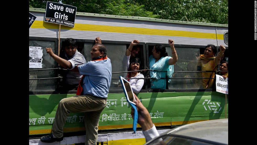 Activists shout slogans after being detained following a protest in New Delhi on April 22.