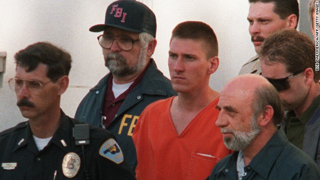 PERRY, OK - APRIL 22:  This 21 April 1995 file photo shows Timothy McVeigh, 27, (C) being led from the Noble County Courthouse in Perry, Oklahoma, by FBI agents after being charged with involvement in the 19 April 1995 bombing of the Alfred P. Murrah Federal Building in Oklahoma City, Oklahoma. McVeigh was found guilty 02 June in Denver on 11 counts dealing with the bombing, including the deaths of eight federal agents. McVeigh, convicted on first-degree murder charges for the 19 April fuel and fertilizer bomb explosion, was sentenced to death in 1997. The blast, the worst terror attack on US soil, killed 168 people and injured more than 500.  (Photo credit should read BOB DAEMMERICH/AFP/Getty Images)