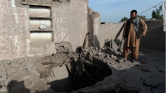 A resident on the roof of a home damaged by a earthquake in Charbagh village, Nangarhar province on April 24, 2013.