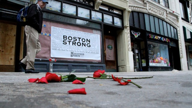 Flowers lie on the sidewalk adjacent to Boston's Boylston Street, which reopened a week after the twin terror bombings.