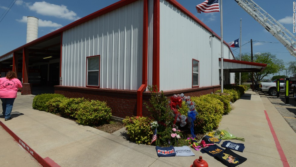 A memorial is set up on Monday, April 22, outside a fire station for the firemen who perished in the explosion.