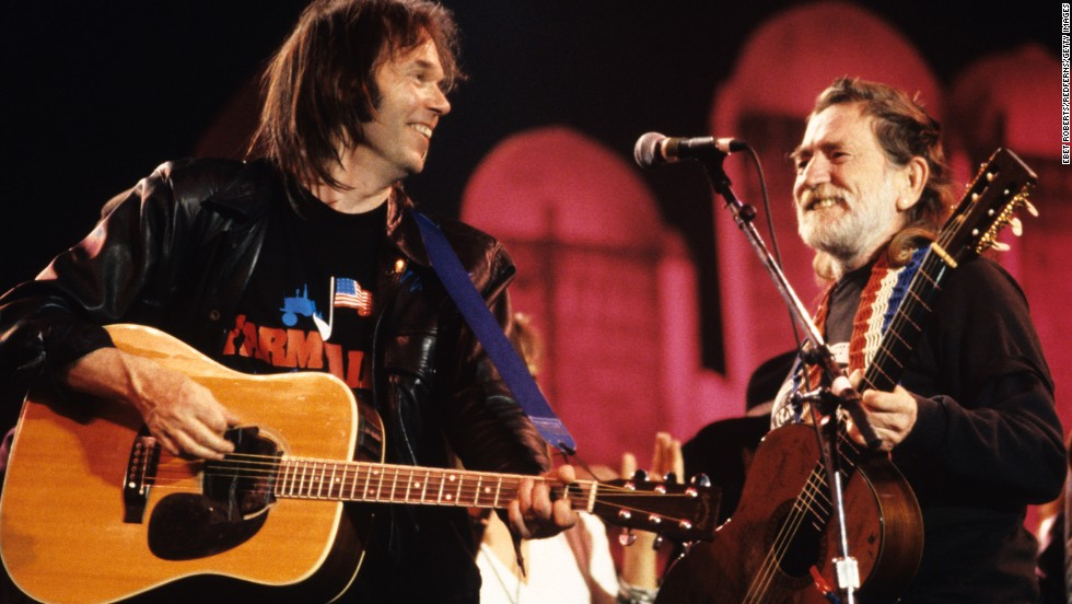 Neil Young and Nelson perform together at Farm Aid in Indianapolis in 1990.