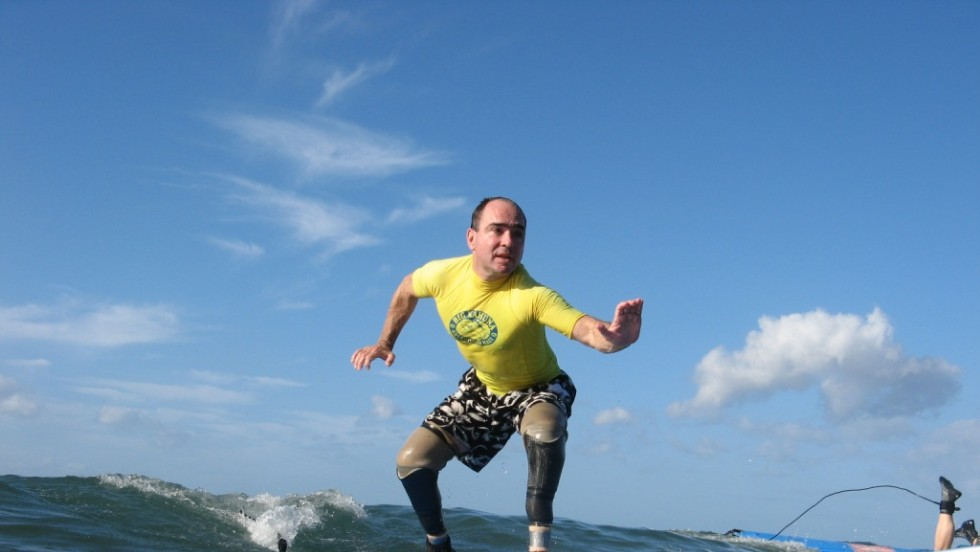 Cain enjoys and competes in a variety of adaptive sports, including surfing.