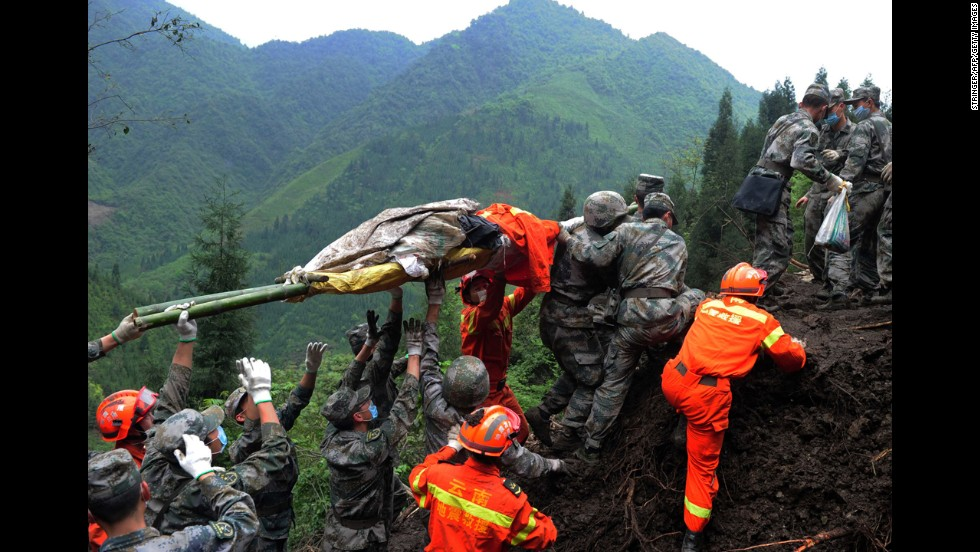 Rescuers carry a victim's body in the Taiping township of Ya'an on April 25.