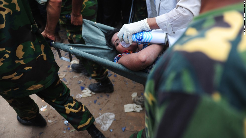 Bangladeshi army personnel recover a survivor from rubble on April 26, 48 hours after the collapse.
