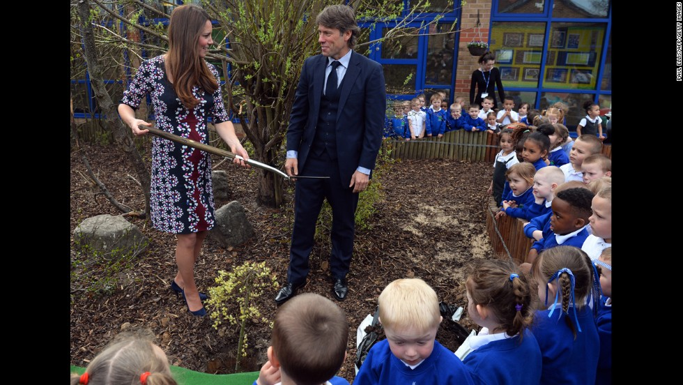 During a visit on April 23 to the Willows Primary School in Manchester, the Duchess plants a willow tree with comedian John Bishop to launch a new school counseling program.