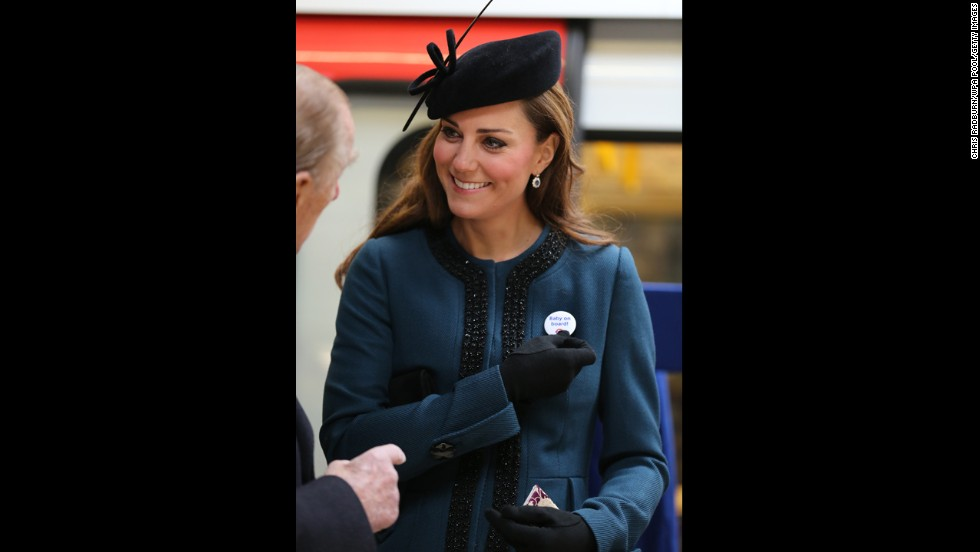 "To mark the 150th anniversary of the London Underground on March 20, the Duchess of Cambridge visits the Baker Street Underground Station, wearing a pin that reads, ""Baby on Board!"""