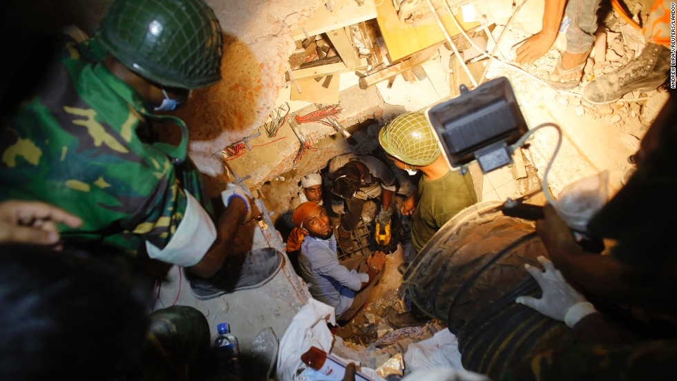 Rescue workers look for trapped garment workers on April 26.